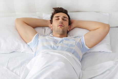 man sleeping on mattress