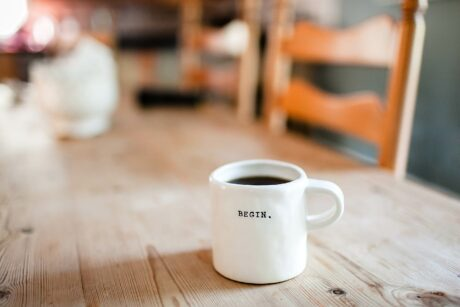 Begin coffee cup on wooden rustic dining table