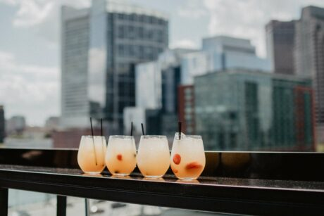 Summer cocktails placed in front on city skyline