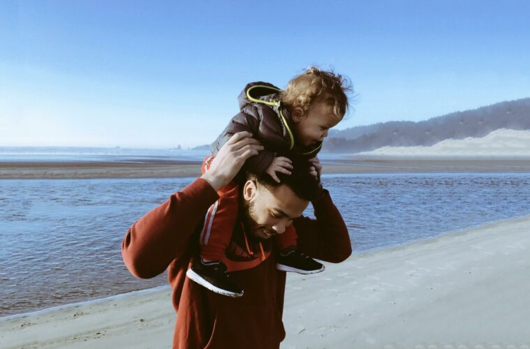 Father and son on the beach having fun
