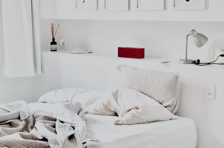 white bedroom with table lamp