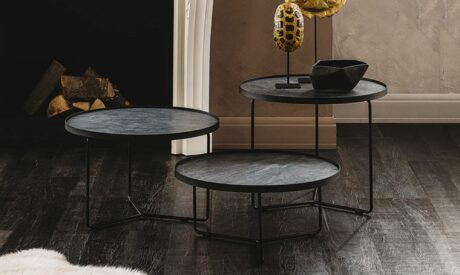 Trio of sleek metallic coffee tables