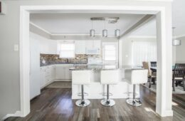 White kitchen with dark wooden flooring