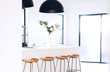 Natural light beaming into white kitchen