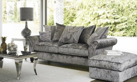 Living room set including fabric sofa and footstool