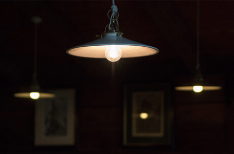 Bright lighting from energy-efficient LED bulbs in dark room