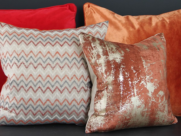 Res, orange & rust cushions